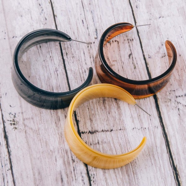 "Wide resin open hoop earrings. Approximately 2"" in diameter, .5"" wide."