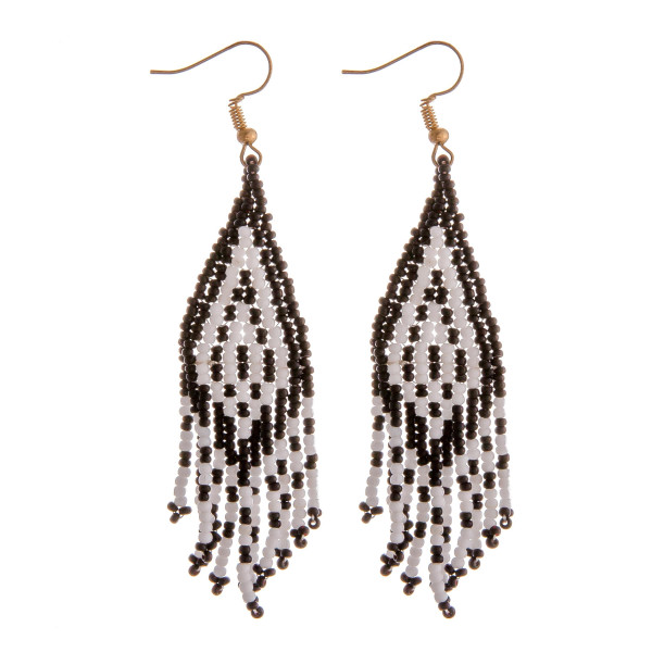 "Seed beaded tassel dangle earrings. Approximately 3.5"" in length."