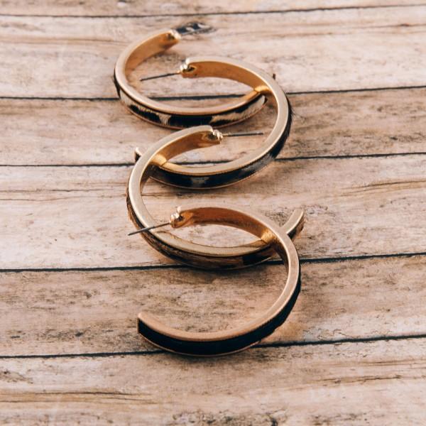"Fur faux leather leopard print metal encased open hoop earrings. Approximately 1.5"" in diameter"