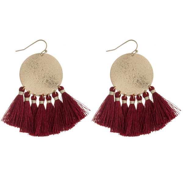 "Fan tassel metallic disc dangle earrings. Approximately 2.25"" in length."