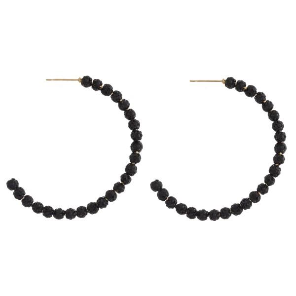 "Rhinestone studded beaded open hoop earrings. Approximately 1.75"" in diameter."