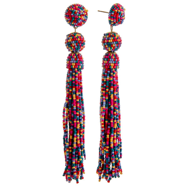 "Seed beaded tassel dangle earrings. Approximately 4"" in length."