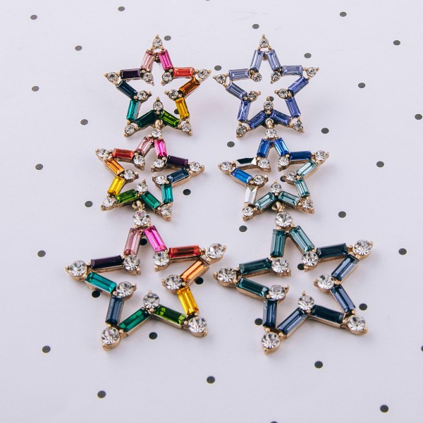 "Heavyweight rhinestone encased star drop earrings. Approximately 3.25"" in length."