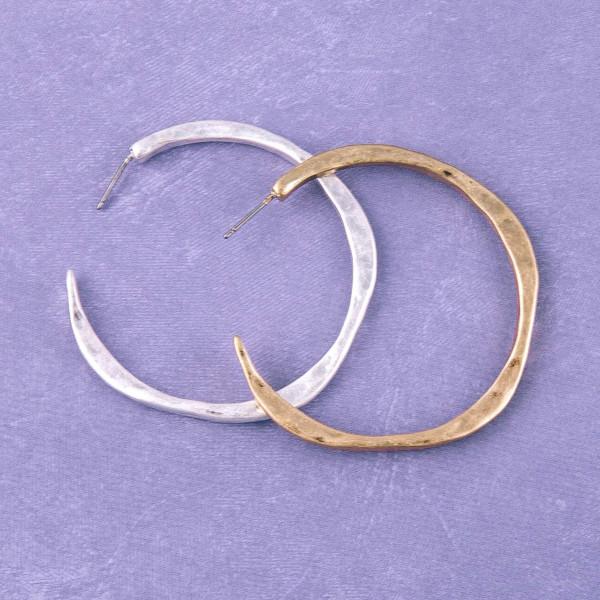 """Hammered metal open hoop earrings. Approximately 2"""" in diameter."""