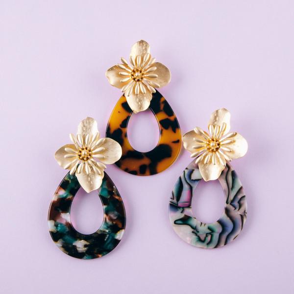 "Flower accented marble resin teardrop earrings. Approximately 3"" in length."