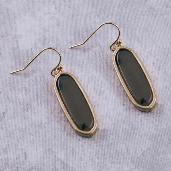 """Metal encased oblong resin dangle earrings. Approximately 1.25"""" in length."""