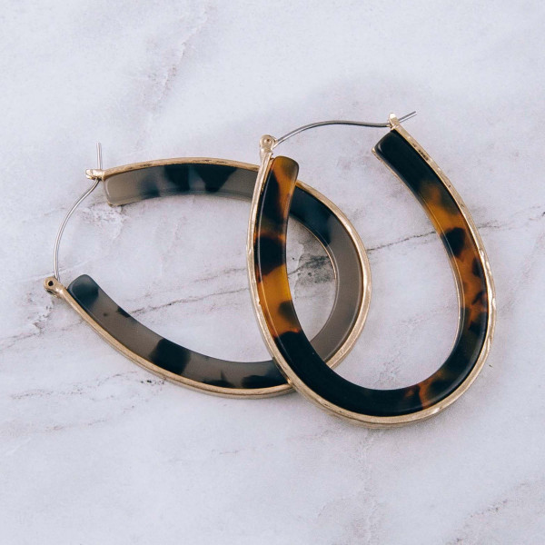 """Metal encased resin pin catch hoop earrings. Approximately 2"""" in length."""