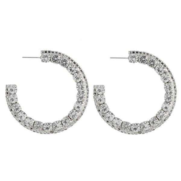 "Rhinestone cubic zirconia open hoop earrings. Approximately 2"" in diameter."