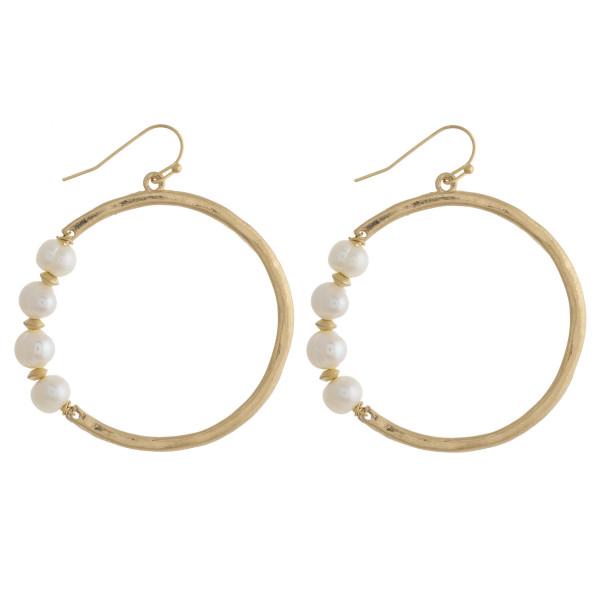 """Hammered freshwater pearl accented dangle earrings. Approximately 2"""" in diameter."""