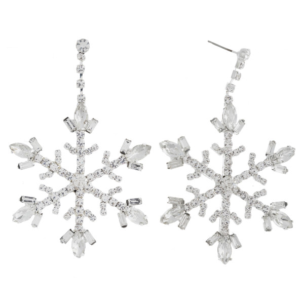"Rhinestone cubic zirconia winter snowflake dangle earrings. Approximately 3"" in length."