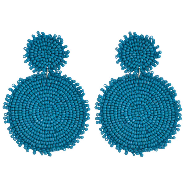 """Seed beaded felt disc earrings featuring short tassel accents. Approximately 3"""" in length."""