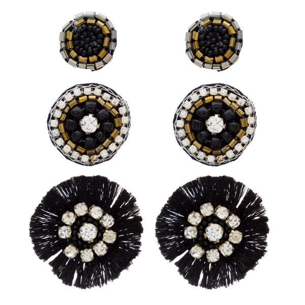 "Trio seed beaded felt disc earring set featuring rhinestone and tassel accents. Approximately .5"" in diameter - 1"" in diameter."