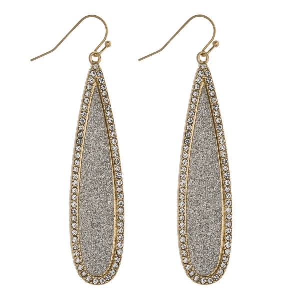 "Two tone glittery rhinestone encased pave teardrop earrings. Approximately 2.5"" in length."