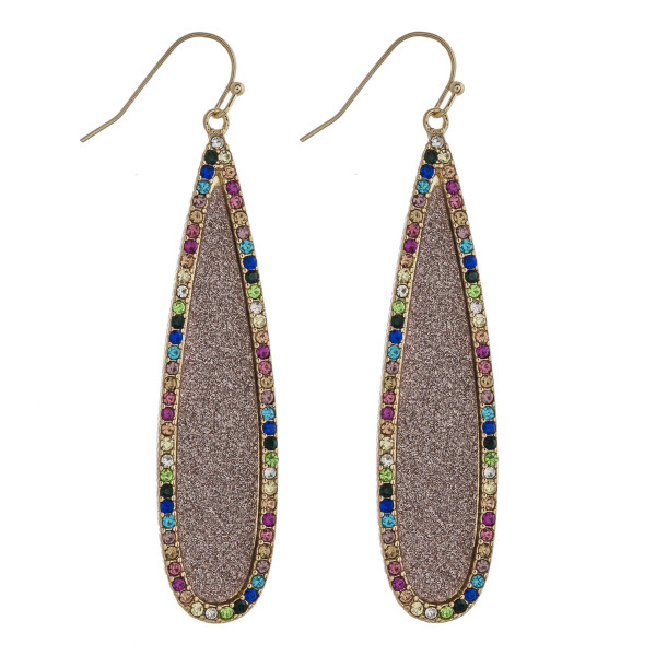 "Glittery rhinestone encased pave teardrop earrings. Approximately 2.5"" in length."