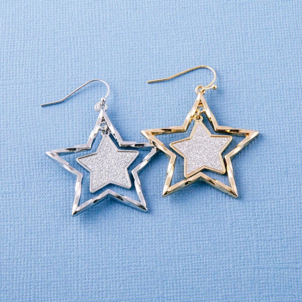 "Two tone glittery star nested dangle earrings. Approximately 1.5"" in length."
