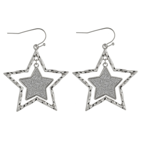 "Glittery star nested dangle earrings. Approximately 1.5"" in length."