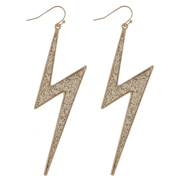 "Glittery lightning bolt earrings. Approximately 3.5"" in length."