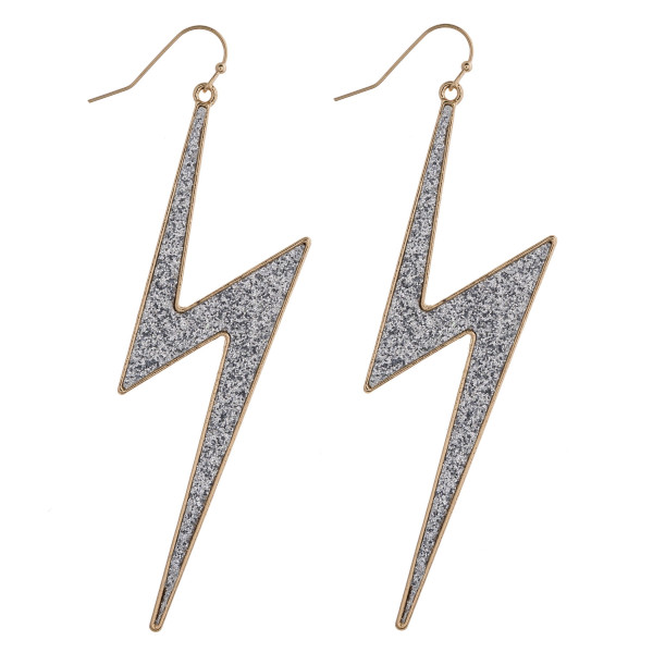 "Two tone glittery lightning bolt earrings. Approximately 3.5"" in length."