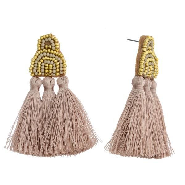 """Seed beaded felt boho tassel earrings. Approximately 2.5"""" in length."""