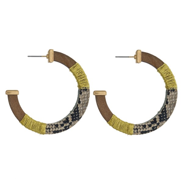 "Thread wrapped snakeskin open hoop wood earrings. Approximately 2"" in diameter."