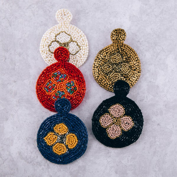 "Seed beaded felt flower disc earrings. Approximately 3"" in length and 2"" in diameter."
