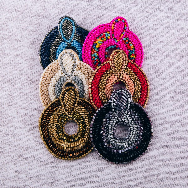 """Seed beaded cut out felt disc boho earrings. Approximately 2.5"""" in length and 2"""" in diameter."""