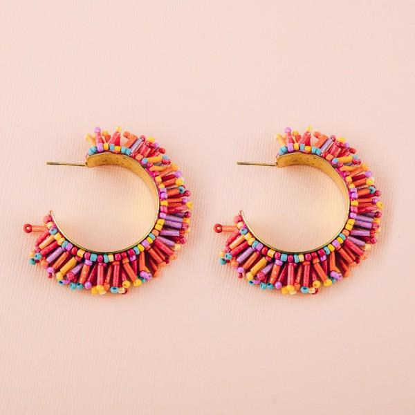 "Seed beaded tassel open hoop earrings. Approximately 2"" in diameter."
