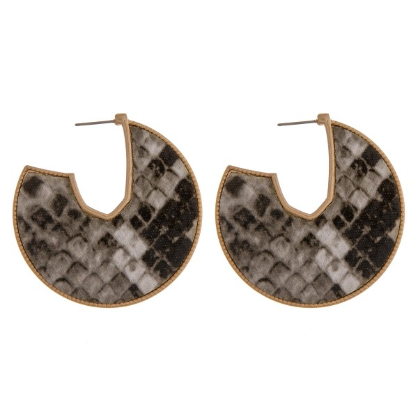 "Faux leather snakeskin encased open hoop disc earrings.  - Approximately 2"" in diameter"