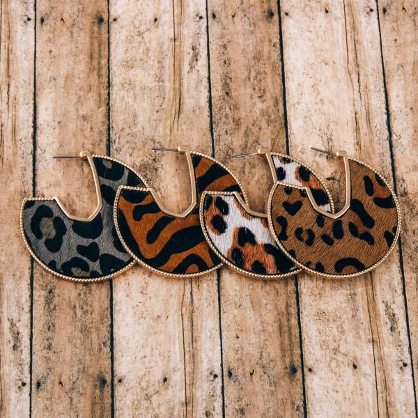 """Cowhide leopard print encased open hoop disc earrings.  - Approximately 2"""" in diameter"""