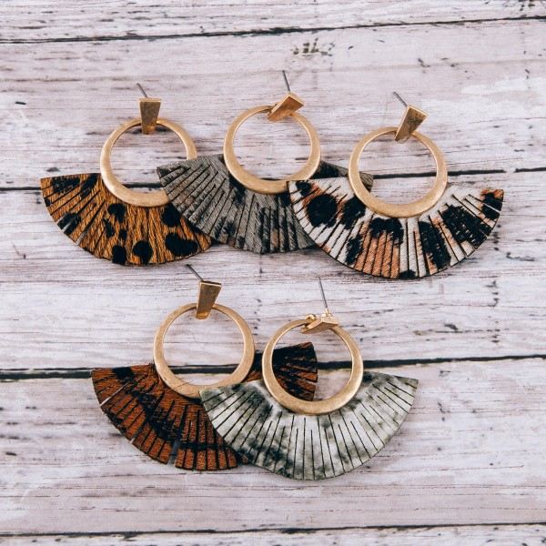 "Cowhide leopard print faux leather tassel earrings.  - Approximately 2"" in length"
