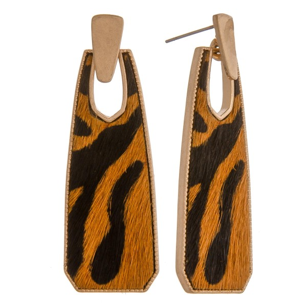 "Cowhide encased animal print oblong earrings.  - Approximately 2"" in length"
