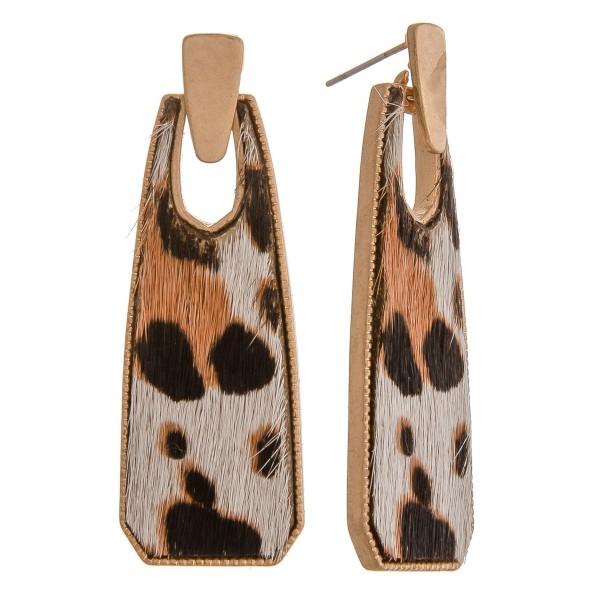 "Cowhide encased leopard print oblong earrings.  - Approximately 2"" in length"