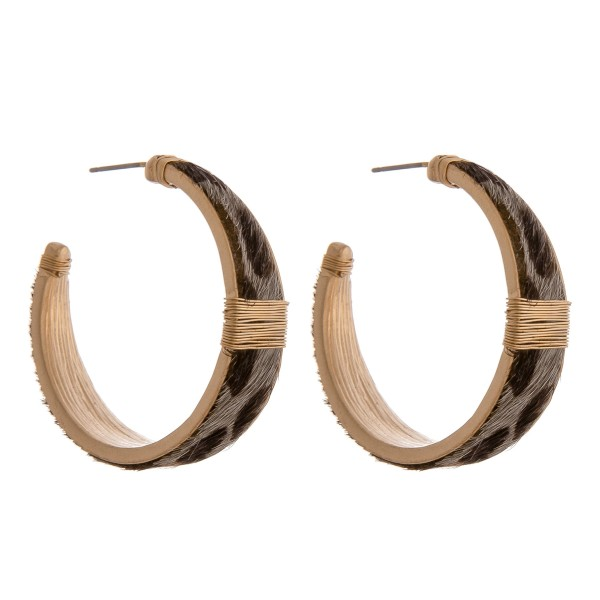 "Cowhide leopard print hoop earrings with wire wrapped details.  - Approximately 1.5"" in diameter - Approximately 1cm in width"