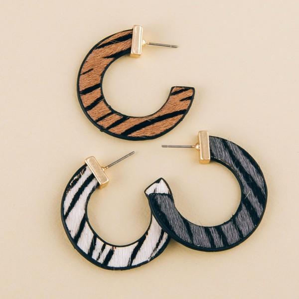 "Genuine leather double sided animal print hoop earrings.  - Approximately 1.5"" in diameter"
