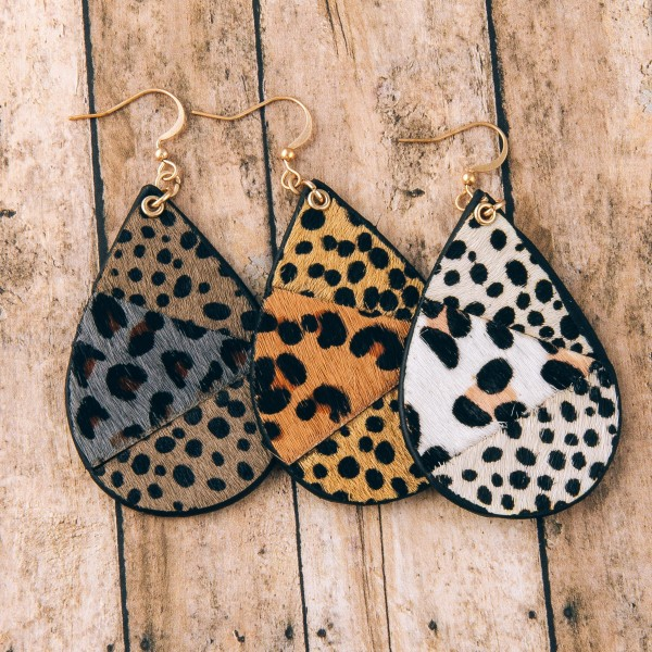 "Genuine leather double sided multi animal print teardrop earrings.  - Approximately 2.75"" in length"