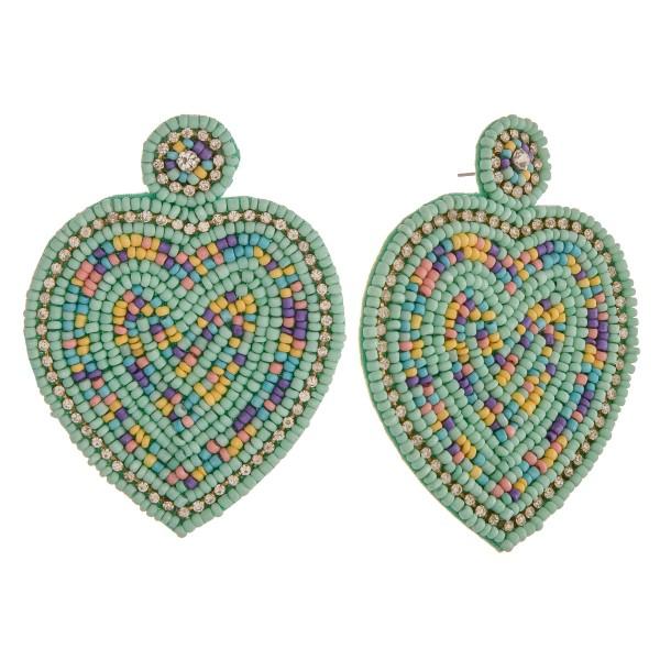 "Seed beaded felt heart statement earrings.  - Approximately 3.25"" in length"