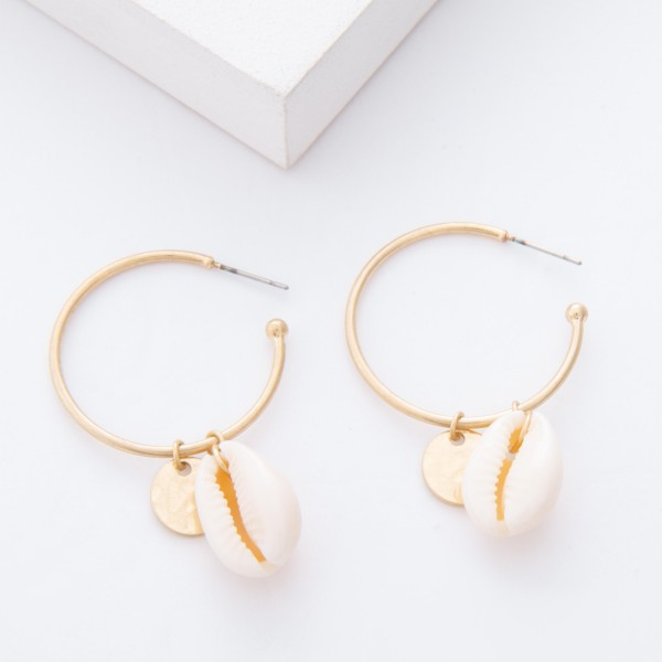 "Worn Gold Puka Shell Drop Open Hoop Earrings.  - Hoop approximately 1.25"" in diameter - Approximately 2"" L overall"