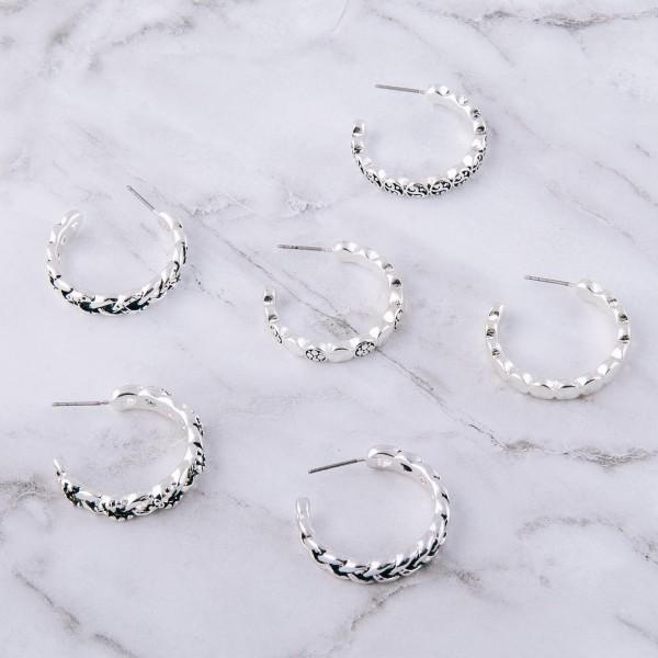 "Antique silver chain linked open hoop earrings.  - Approximately 1.25"" in diameter"