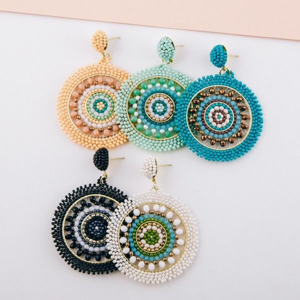 "Seed beaded woven bohemian earrings with glass bead details.  - Approximately 2.5"" in length and 2"" in diameter"