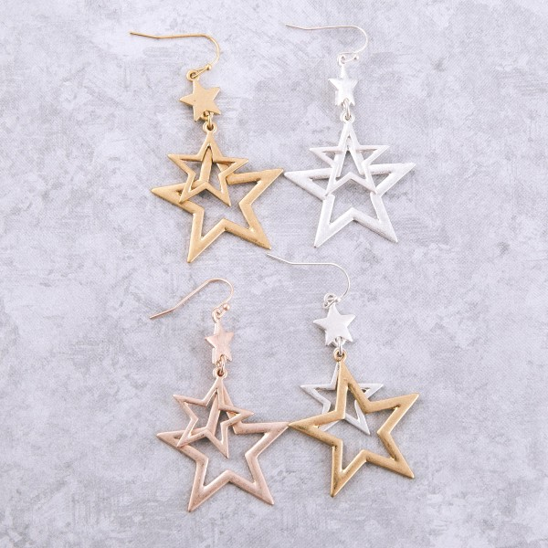 """Metal cut out star dangle earrings.  - Approximately 2.5"""" L"""