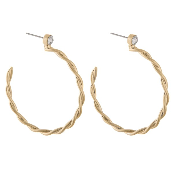 "Twisted metal hoop earrings with rhinestone accent.  - Approximately 2"" in diameter"
