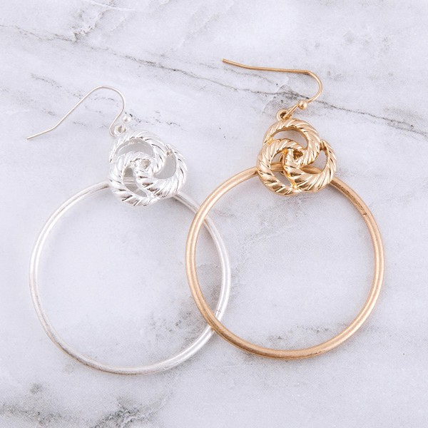 """Knotted metal disc drop earrings.  - Approximately 2"""" L  - 1.5"""" in diameter"""