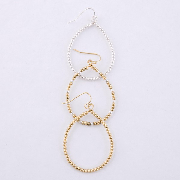"Metal tone beaded teardrop earrings.  - Approximately 2"" L"