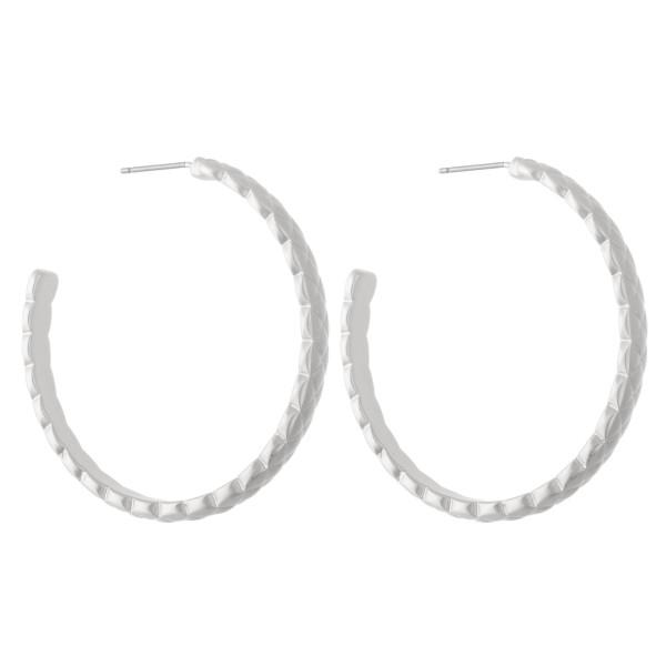 """Metal hoop earrings featuring textured details.  - Approximately 1.5"""" in diameter"""