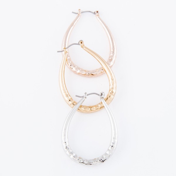 """Short oval hoop earrings featuring textured details.  - Approximately 1.5"""" L"""