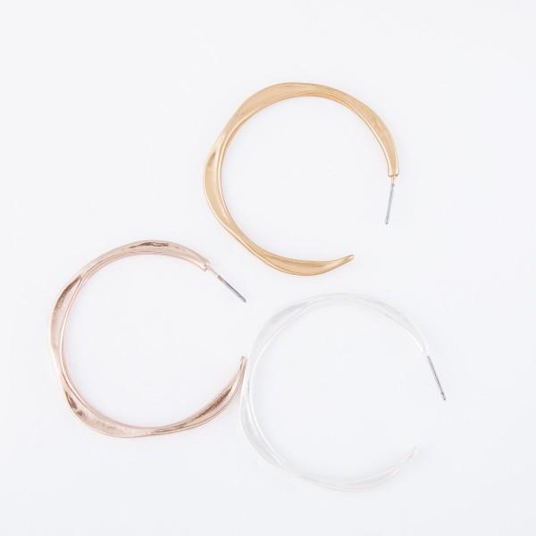 "Hammered metal earrings  - Approximately 1.5"" in diametet"