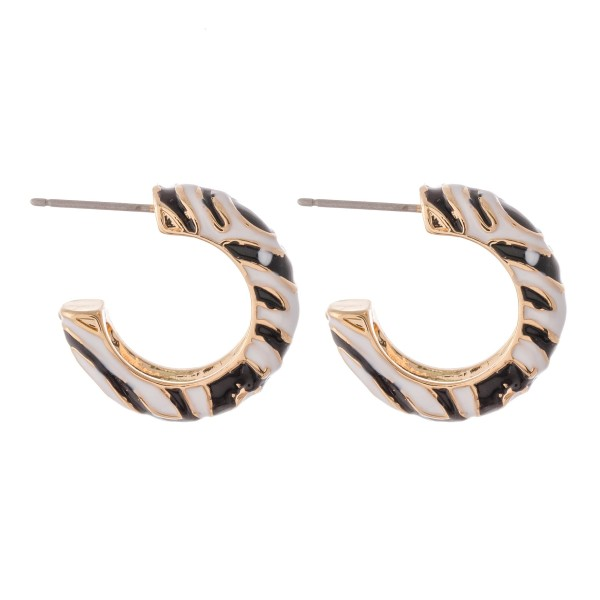 "Enamel coated zebra print short hoop earrings.  - Approximately .75"" in diameter"