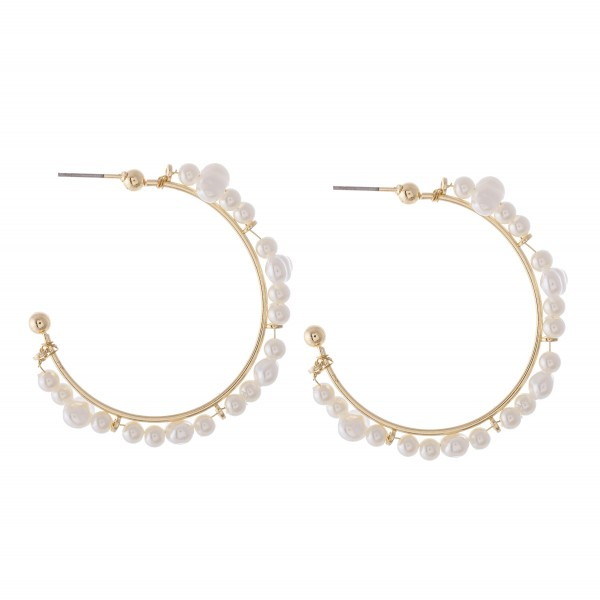 "Irregular pearl wire beaded open hoop earrings.  - Pearls vary in size - Approximately 2"" in diameter"