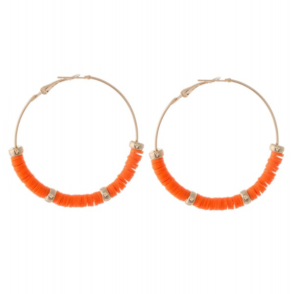 """Polymer Clay spacer disc beaded statement hoop earring with gold accents.  - Approximately 2"""" in diameter"""