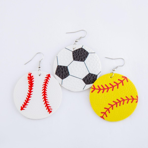 "Softball faux leather drop earrings.  - Approximately 2.5"" L - 1.75"" in diameter"